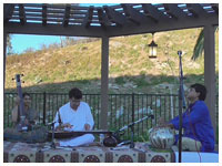Accompanying Mohan Veena player Suman Laha at at 'East Meets West' concert, San Diego, CA